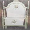 Hand painted twin size bed, complete with iron side rails.   110.00.
