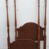 Twin size four posts bed, complete with iron side rails.    85.00