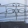 King size iron bed.   Complete with iron rails / frame.    250.00.