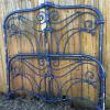 Heavy iron queen size bed, complete with side rails and supports.   299.00.