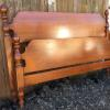 Nice full size maple bed, complete with iron side rails.   75.00.