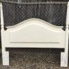 Full or queen size wood headboard.   30.00.