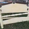 Nice heavy wood bed, full size.  Complete with iron side rails.   75.00.