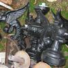 10 foot tall light post with gargoyles.  Pictures are of it laying on its side.   Priced 695.00.